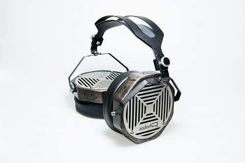 grey black and grey cordless headphone metal