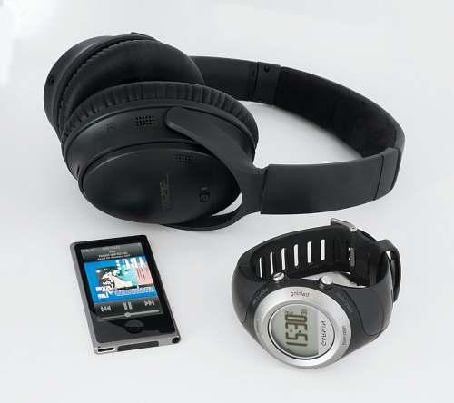 headphones black Bose wireless headphones near smartwatch and iPod cell phone