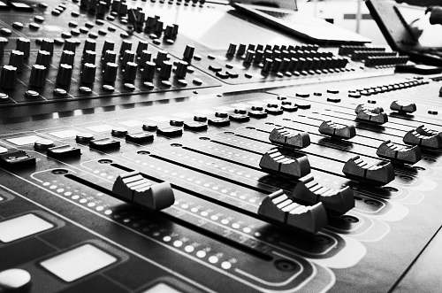 black-and-white close up photo of audio mixer console