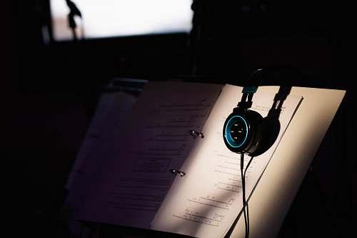 headphones headphones on music book headset