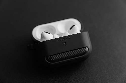 adapter white apple earpods in black case black-and-white