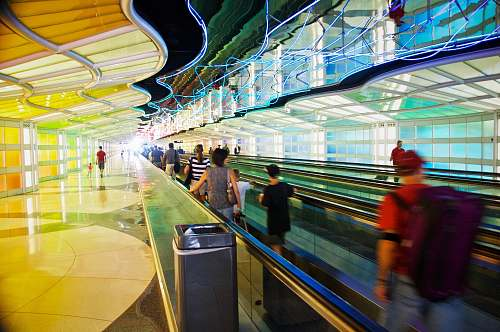 chair people on walkalator o'hare international airport