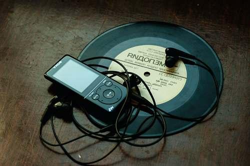belarus in-ear headphones plugged in black Sony Walkman on vinyl record music