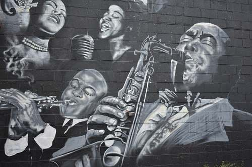detroit grayscale photo of men playing musical instruments mural