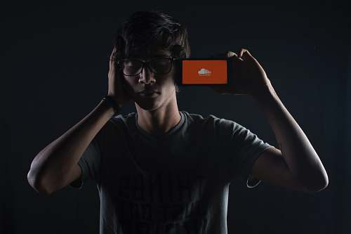 person man listening to Soundcloud music on smartphone people