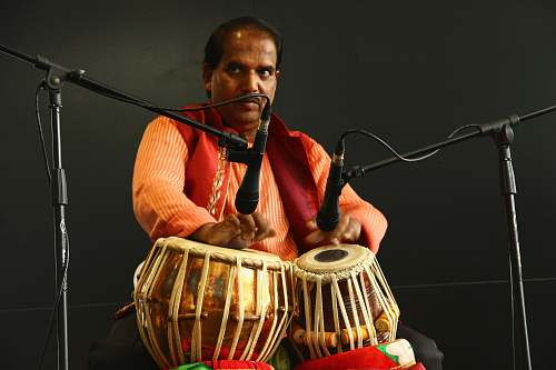 person man playing a drum instrument people