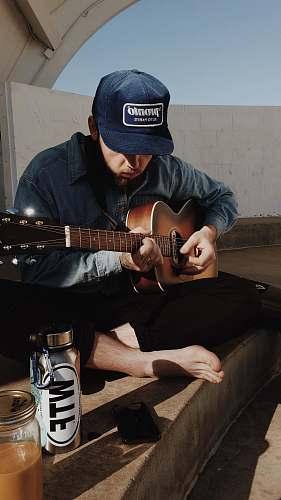 person man playing guitar guitar