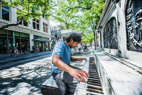 person man playing piano on street people