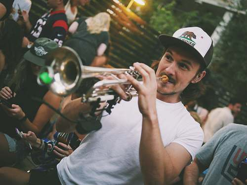 person man playing trumpet people