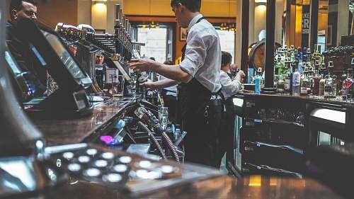person man preparing beverage drink in bar people