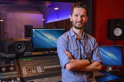 person man standing behind audio mixer in studio people