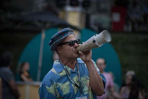 person man using megaphone sunglasses