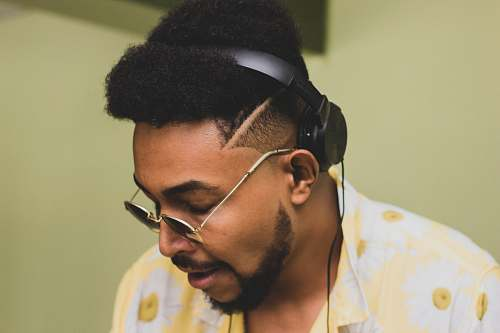 person man wearing sunglasses and headphones headphones