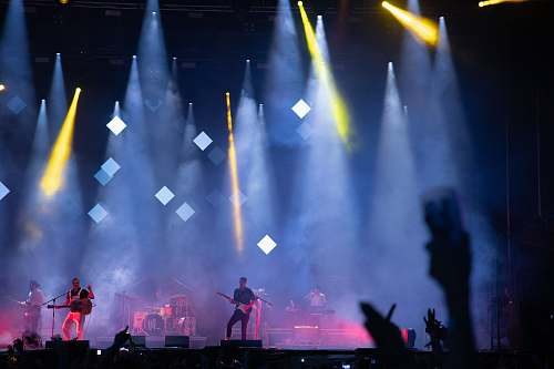 lighting men playing guitar on stage stage