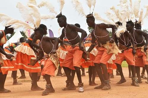 person people dancing on brown soil people