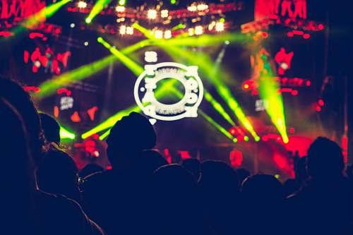 person people in dancing in green lights people