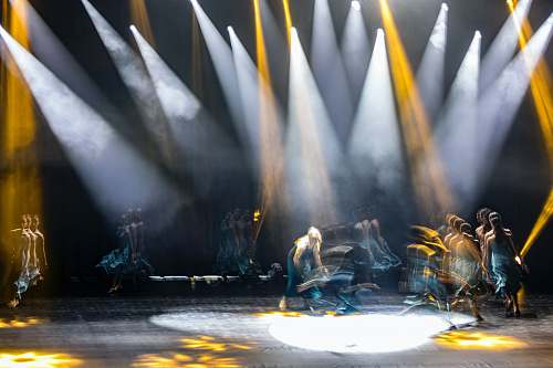 person people performing on stage lighting
