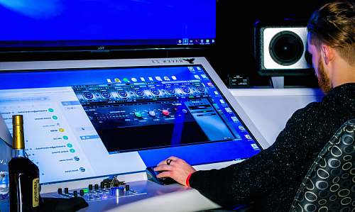 person person in black long sleeve shirt playing game on computer electronics