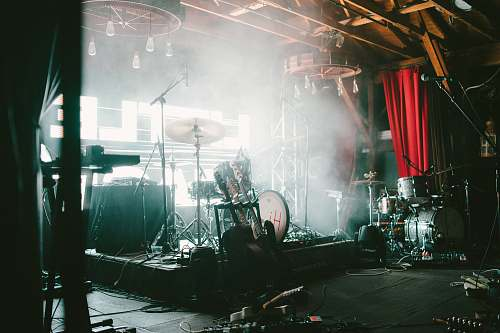 person photo of brown and gray drum set stage
