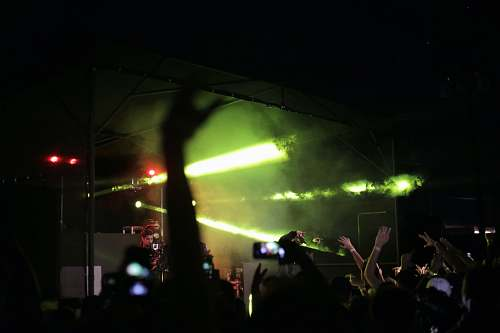 photo person silhouette of crowd raising hands fronting concert stage people free for commercial use images