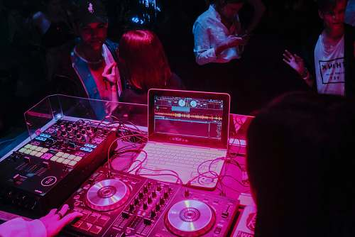 person white laptop and audio system dj