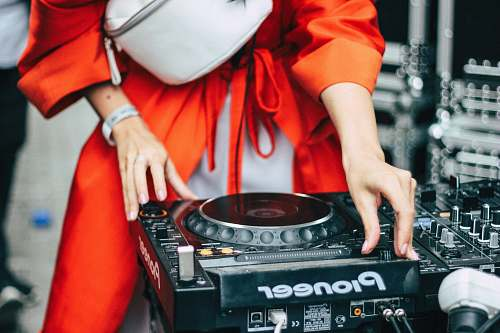 person woman playing black Pioneer turntable dj