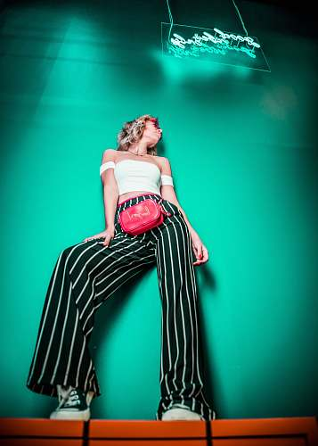 person women's black and white striped pants people