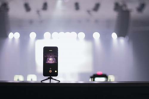 recording selective focus photography of iPhone displaying theater stage