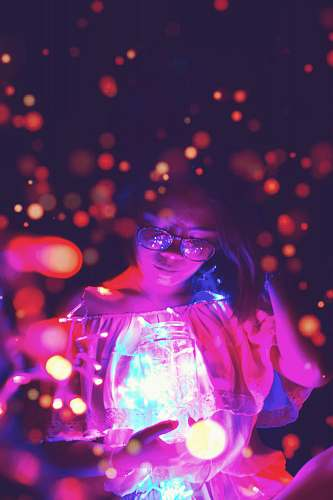 confetti woman holding glass jar with bokeh light background paper