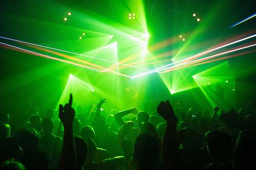club people dancing inside room with green lights night club