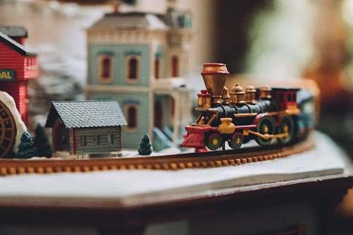 train selective focus photography of village miniature transportation