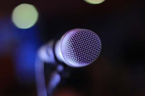 mic selective focus photography of microphone sing
