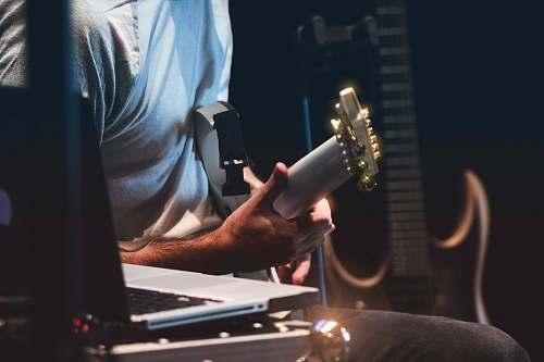 peru person holding white guitar dj