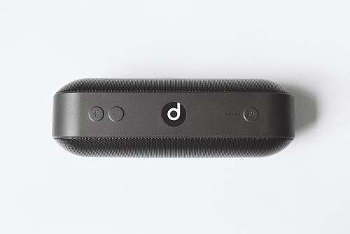 grey black Beats by Dr Dre beatspill + on white surface electrical device