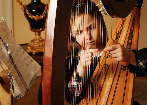 hand girl playing harp wrist