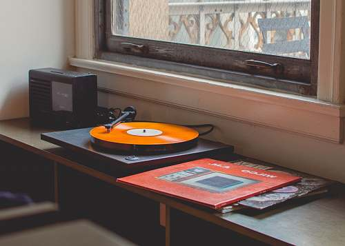 vintage gray turntable playing los angeles