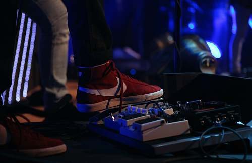 lighting man stepping on pedal effects electronics