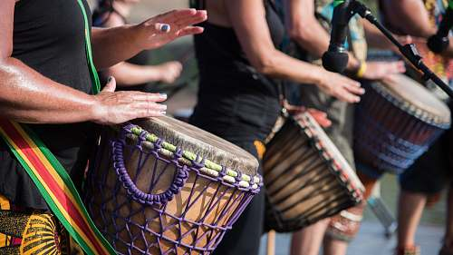 drum people playing goblet drums during daytime maitland