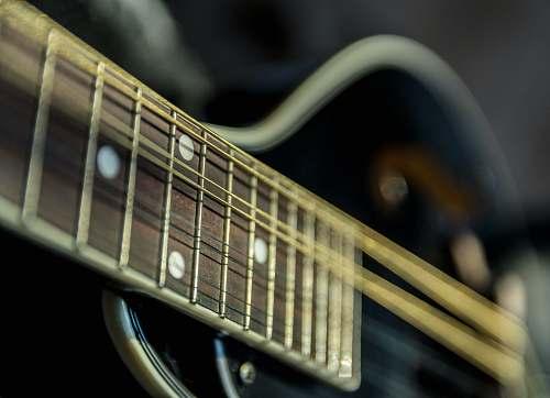guitar selective focus photography of guitar electric guitar