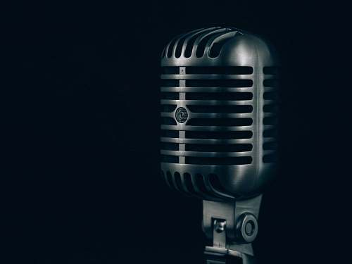 microphone shallow focus photography of condenser microphone metal
