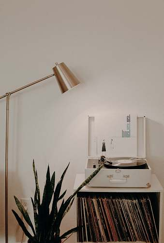 interior white turntable on white wooden organizer with vinyl record sleeves home