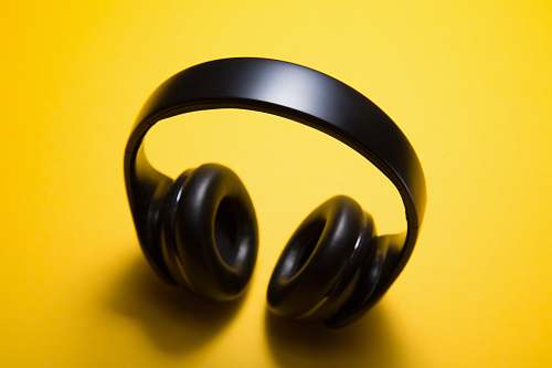 yellow wireless headphones with yellow background headphones
