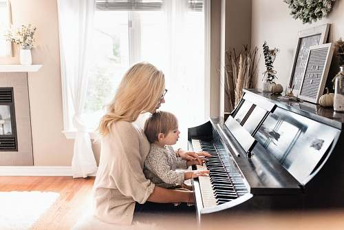 person woman and child playing piano human