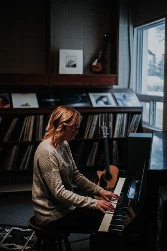 people woman playing piano human