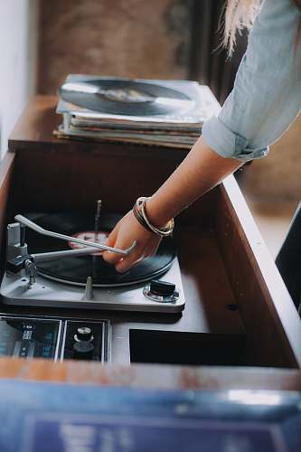 austin person holding gray and black vinyl record player united states