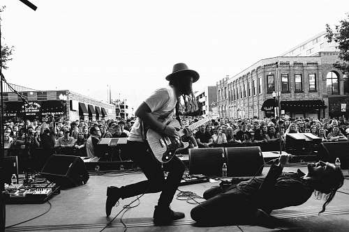 human grayscale photography of concert during daytime black-and-white