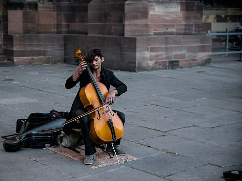 human man playing cello person
