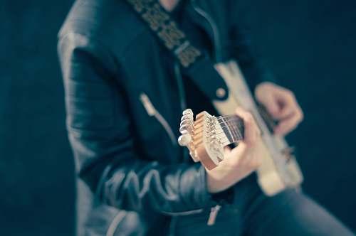 human man playing guitar person