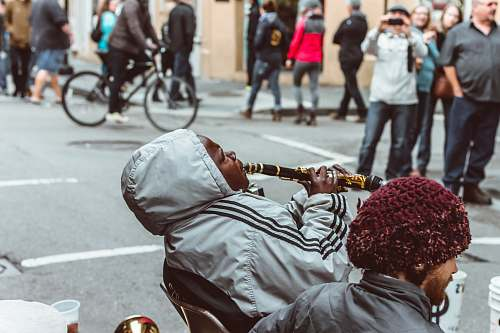 bike man sitting on chair playing flute person