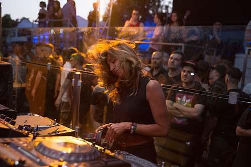 human woman playing dj turntable person